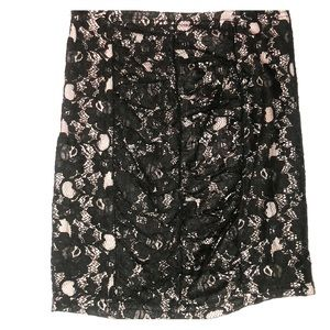 Black lace on top of a light pink mini skirt